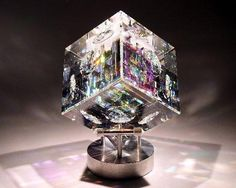 Optic and Dichronic Glass Cube on Revolving Metal Base. Jack Storms