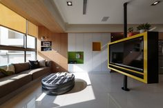 pivoting tv turns playful apartment into entertainment area 1 Pivoting TV Turns Playful Apartment into Entertainment Area