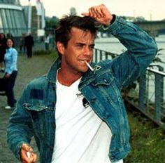 Robbie Williams looking delightful in a denim jacket