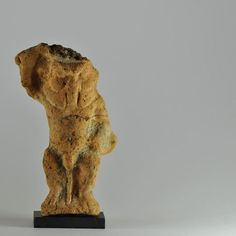 Egyptian Bes, Ptolemaic period, 2nd-1st century B.C. Pottery, naked, wearing a feathered headdress, standing with hand on his knee and other raised with sword, the back is unmodelled, beautifully detailed with excellent style, 16.9 cm high. Private collection