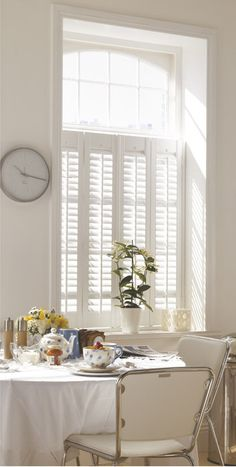 white painted wooden shutters or venetian blinds