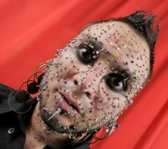 Axel Rosales and his 280 facial piercings - He set a record with his face full of metal in February 2012. I wonder how long it takes to take his piercings in and out?