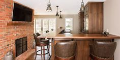 Rochester Dining Area, Living Room & Bar Area - Home Remodeling | Home Renovations Rochester NY | Norbut Renovations #bar #brick #walnut