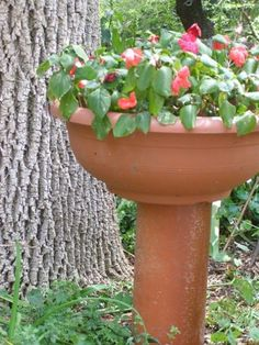 Clay bowl w/ ground tile stand..great idea!!!  Garden Crafts Decorate Outdoor Living Spaces