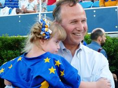 Kayla Kosmalski, the Blue All-Star Buddy at the June 23 DFRC Blue-Gold All-Star Football Game, gets a hug from Gov. Markell.