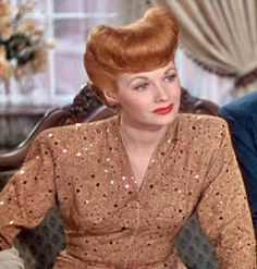"Lucille Ball in ""Best Foot Forward."" The hair, the shoulder pads, everything about this look is so powerful."