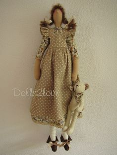 Tilda doll Piper wearing a brown and beige liberty by Dolls2love