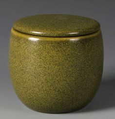 China, 20th C., tea-dust glazed jar, primarily a green color comprising of yellow highlights and black low-lights. Height 4 in., Width 4 in.