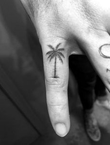 Palm tree tat on finger by Daniel Winter