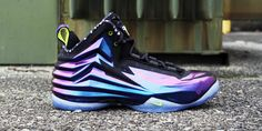 Nike Chuckposite crafted in a cave purple with a translucent bottom.