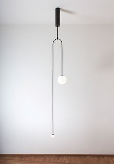 Michael Anastassiades creates minimal lighting designs from glowing spheres. Michael Anastassiades creates minimal lighting designs from glowing spheres. Home Lighting Design, Architectural Lighting Design, Interior Lighting, Modern Lighting, Lighting Ideas, Modern Lamps, Light Design, Deco Luminaire, Luminaire Design