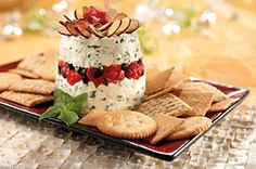 This Layered Basil-Roasted Red Pepper Spread is a great holiday appetizer to serve with RITZ crackers. Just layer roasted red peppers and olives  in a creamy herb spread.