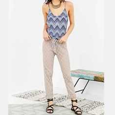 Urban Outfitters Boho Chic Crochet Pants Crochet Pants. Very stylish and comfortable. Can be worn as a cover up to the resort or beach. Drawstring waist and very loose fitting can fit a bigger size or smaller size. Comes with a adjustable drawstring. Tag size is Medium Urban Outfitters Pants Skinny