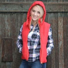 Keep warm this season with this faux-fur lined hooded vest. Side stitching and feminine cut are extremely flattering. Runs small. We suggest ordering a size larger than normal.
