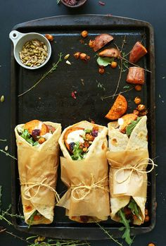 Easy, 30-minute Vegan Thanksgiving Wraps with roasted sweet potatoes, chickpeas, and garlic-dill sauce, inside homemade Garlic-Herb Flatbreads!