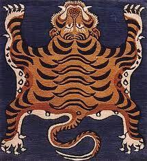 Tibetan tiger rugs like I used to see at the Flea market in Berkeley. Tibetan Rugs, Tibetan Art, Tibetan Dragon, Tiger Rug, Image Chat, Medieval Art, Small Art, Ancient Art, Textiles