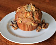 Muffins with Bananas and Nuts - Ingredients:      1 1/2 cups all-purpose flour     1 1/2 teaspoons baking powder     1/4 teaspoon baking soda     1/4 teaspoon baking soda     1/8 teaspoon salt     3 egg whites     2 cups mashed bananas     3/4 cup white sugar     3 tablespoons vegetable oil     1 teaspoon lemon zest     1/4 cup chopped walnuts