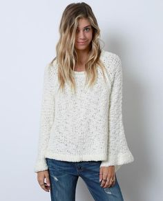 +Textured sweater top features cut-out details on back  +Raglan bell sleeves