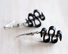 Upcycled bicycle innertube squiggle earrings with freshwater pearls by livelyleafdesigns www.etsy.com/listing/160495818/black-and-white-squiggle-earrings-wavy
