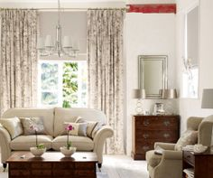 photo of natural neutral colours sophisticated stylish grey silver white walnut kyoto laura ashley living room lounge with chandelier lighti...