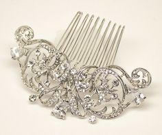 """This stunning vintage inspired bridal hair comb features an elegant design of high quality CZ rhinestones.  Perfect for the classic, timeless bride on her wedding day.  This wedding headpiece comb is approximately 3"""" x 1 1/4""""."""