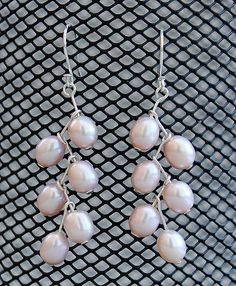 sterling silver and peach fresh water pearls./ You can make these as long as you wish.