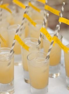 Custom yellow cocktails with gray and white striped paper straws