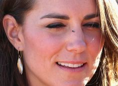 A fly lands on Catherine, Duchess of Cambridge's face as she walk around the base of Uluru on April 22, 2014 in Ayers Rock, Australia. The Duke and Duchess of Cambridge are on a three-week tour of Australia and New Zealand, the first official trip overseas with their son, Prince George of Cambridge.