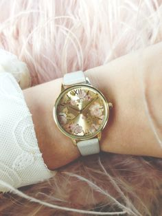 Flowers and feathers - oh my! We adore this pretty in pink shot of our Mink Parlour watch <3 #oliviaburton
