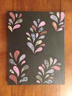 Paint canvas and mod podge scrapbook paper