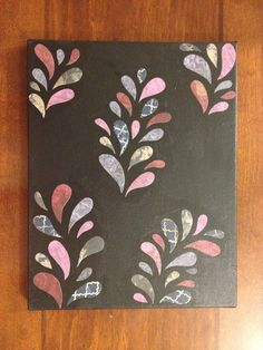 Paint canvas and mod podge scrapbook paper