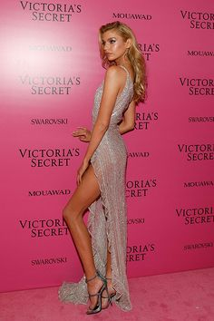 The breathtaking Victoria's Secret Angel Stella Maxwell looked incredibly stunning at the Victoria's Secret Pink carpet in a GEORGES HOBEIKA silk tulle dress fully embroidered with pink, gold and silver crystals in striped pattern, featuring an asymmetrical bodice and thigh slit, from the latest Haute couture Autumn-Winter 17/18 collection.