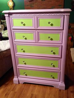 """Painted my daughters old white dresser in Disney's """"Tinkerbell Green"""" and """"Vidia Purple"""" from Walmart to go with her Tinkerbell theme room! Switched out the knobs with some $2 Crystal ones from Hobby Lobby!"""