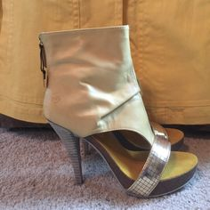NWT High-heeled sandal bootie BRONX Hi heel sandal booty exquisite leather and detail. Color soft yellow leather with gold accent. High end statement piece!   Tags on never worn. Bronx Shoes Sandals