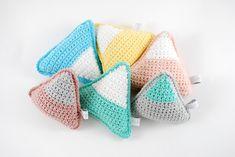 Crochet rattle toys. Pastel colours.