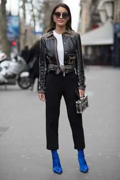 Camila Coelho poses wearing an Elie Saab jacket and Louis Vuitton bag after the Elie Saab show at the Pavillion Cambon during Paris Fashion Week...