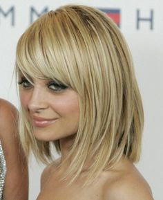 bangs! very chic and cute short or medium hairstyle. pretty shade of blonde