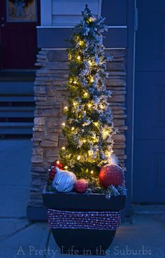Make your own outdoor Christmas trees with lights, tomato cages & evergreen garland! Outdoor Christmas Tree Decorations, Diy Christmas Garland, Christmas Garden, Christmas Love, Winter Christmas, Christmas Lights, Christmas Trees, Christmas Crafts, Outdoor Trees