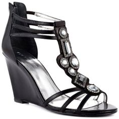 8a9020de3 Act up and create some chaos in the Acimae by Guess. This trendy sandal  features a black leather upper with strap encrusting stones.