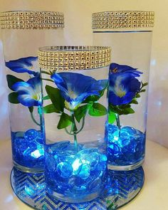 The perfect blue wedding centerpiece or blue decor for any special event like your baby shower, baptism bridal shower, birthday, engagement or graduation party. Also looks great in the house to enhance your home decor or get in the season for EASTER :) NOTE: if you would like this piece to include FLOATING CANDLE just send me a message. INCLUDES: - 3 glass cylinder vases (2 tall 9 & 1 7 vase) with (silver) rhinestone ribbon bling at the top - Blue glass marble stones - 3 submersible w...