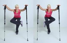hold one pole with both hands above the head with the arms