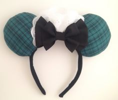 Welcome, foolish mortals....These mouse ears are sure to make them scream with delight! Inspired by our favorite attraction at Disneyland, the Haunted Mansion.     Made out of quality fabrics -black cotton covered headband and double bow with cotton blue and green plaid ears . Accented by white Eyelet trim - these ears are truly something else. Inspired by the maid costumes seen around the Haunted Mansion attraction, these ears are sure to be a hit while attending a swinging wake.