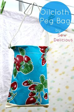 we all know that no amount of fabric dryer sheet smell will ever win against lovely real fresh air so...for you brave ladies who still dare to hang your clothes out on the line here is a sweet peg bag tutorial~~ Sew Delicious: Oilcloth Peg Bag - Tutorial