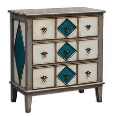 Изготовленный из древесины махагона комод в темно-серой, антично-белой и голубой отделке. Комод украшен геометрическим орнаментом.             Материал: Дерево.              Бренд: Uttermost.              Стили: Классика и неоклассика.              Цвета: Бежевый, Серый.
