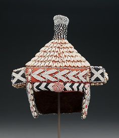 Bead embroidered prestige hat (mpaan) ,20th century, Kuba peoples, Republic of the Congo  Palm leaf fiber textile, cotton textile, cowrie shells and glass beads.  Courtesy of the Dallas Museum of Art
