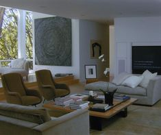 living-rooms-brown-gray-light-wood-art-decoration-books-chaise-longues-coffee-tables
