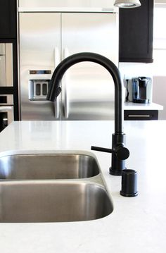 Collection: Solna • Finish: Matte Black • Product: Single-Handle Pull-Down Kitchen Faucet with SmartTouch Technology • Space designed by: Jaime Derringer, Design Milk