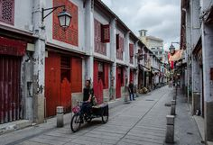 Photo of the Day: A Narrow Walkway In Macau   A view of a narrow pedestrian walkway in #Macau on May 2, 2015. (cotaro70s/Flickr)