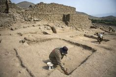 The recent discovery of a ceremonial fireplace believed to be more than 5,000 years old sheds light on one of the oldest populated sites in the Americas. Archaeologists work at the El Paraiso archaeological site in Lima on February 14, 2013