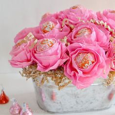"""Another fun idea for teacher –€""""instead of an ordinary bouquet, use pink crepe paper and tape to form a lollipop flower arrangement that's got an extra sweet touch."""